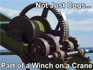 All you see are the cogs. But, they are part of a winch which is part of a crane. Systems in systems in systems.